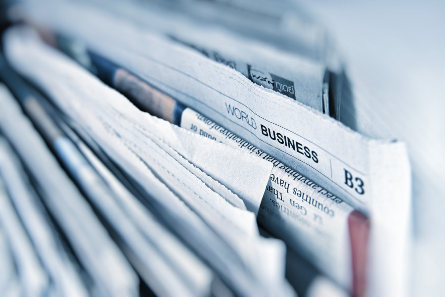 Set of newspapers including one with the heading World Business